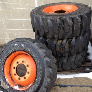 Bobcat Skid Steer off set Rims with Power King 10 16.5 Tires. Set of