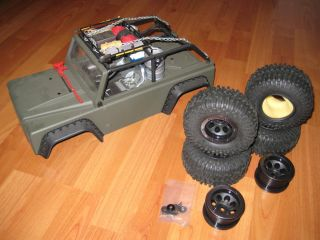 SCX10 TR body with custom paint, 2.2 wheels and rims, and scale extras